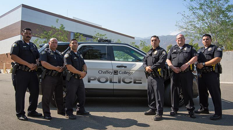 Chaffey Police Officers standing in front of patrol vehicle