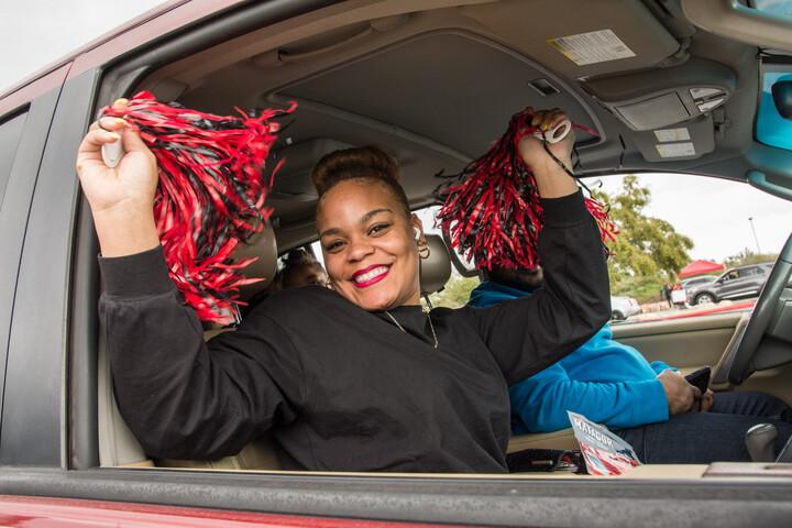 Graduate student in a car celebrating