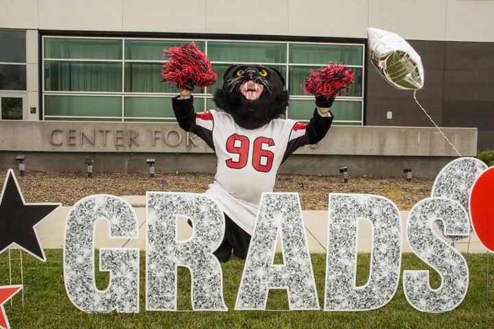 Chaffey Panther mascot celebrating the class of 2021 graduates
