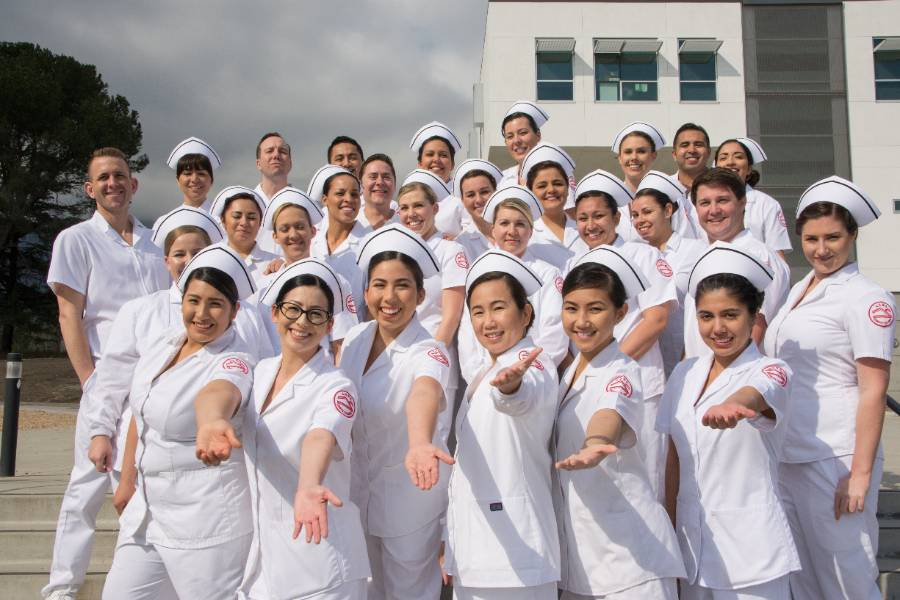 A group photo of nursing students in uniform.