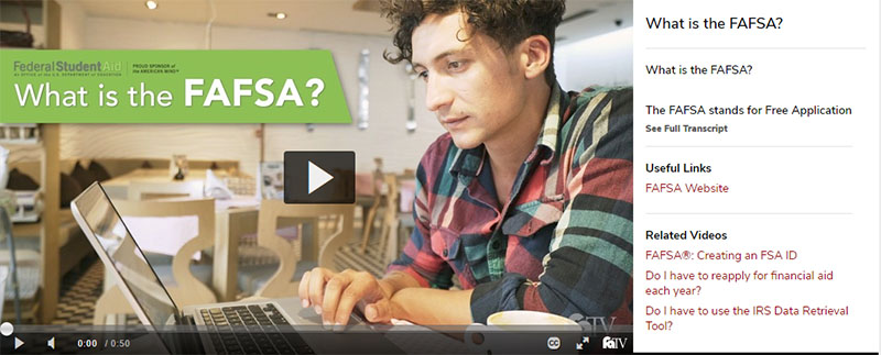 male student working on a laptop. What is the FAFSA?