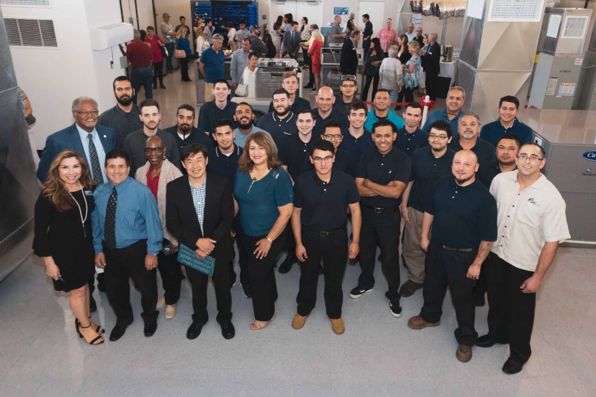 Faculty, staff and community members pose at the Chaffey College HVAC training facility in Chino.
