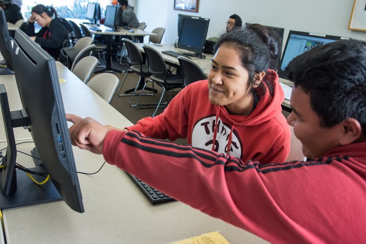 A student works on a laptop at the Chino campus.
